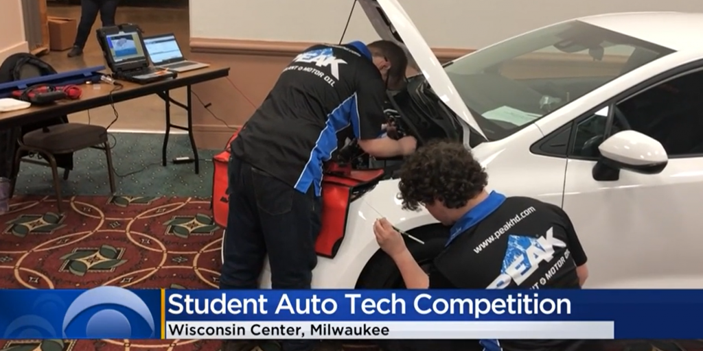 Students work on a car at Milwaukee auto show
