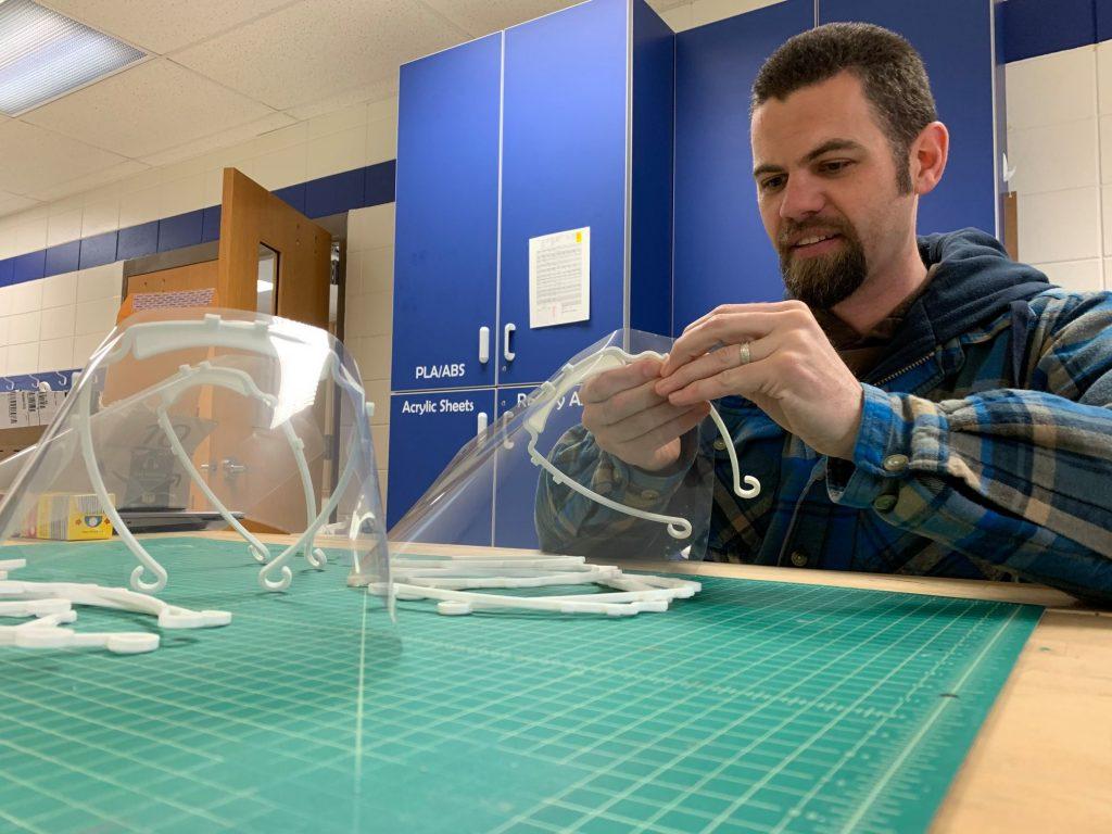 Three Lakes Fab Lab Director Nate Koch and face masks