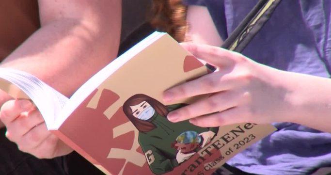 Teens read book